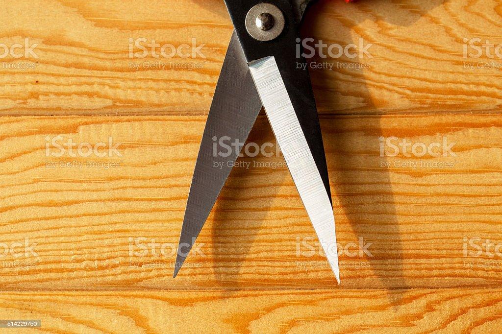 scissor on wooden table stock photo