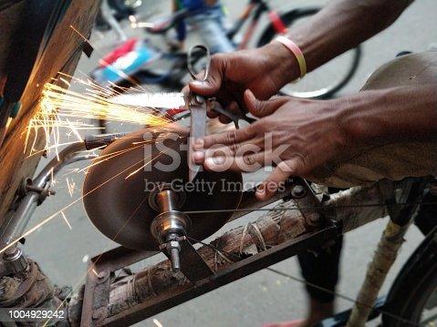 Close-up of Scissor sharpener with sparks