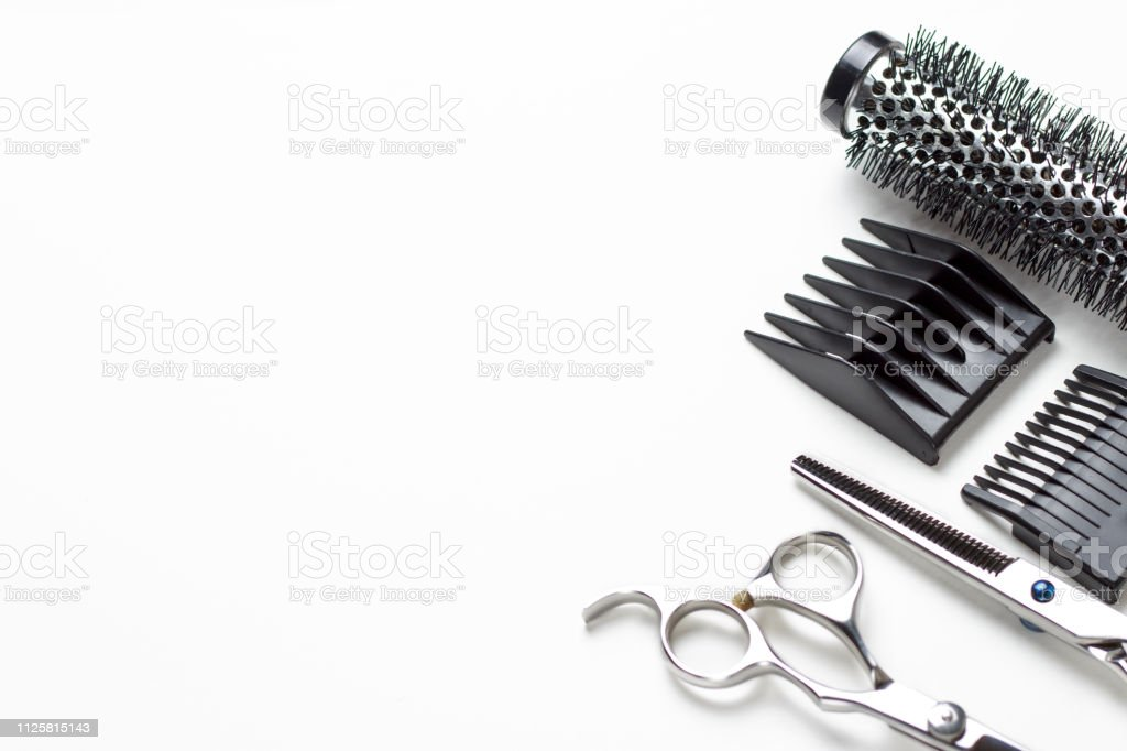 Scissors and comb on a white background, copy space stock photo