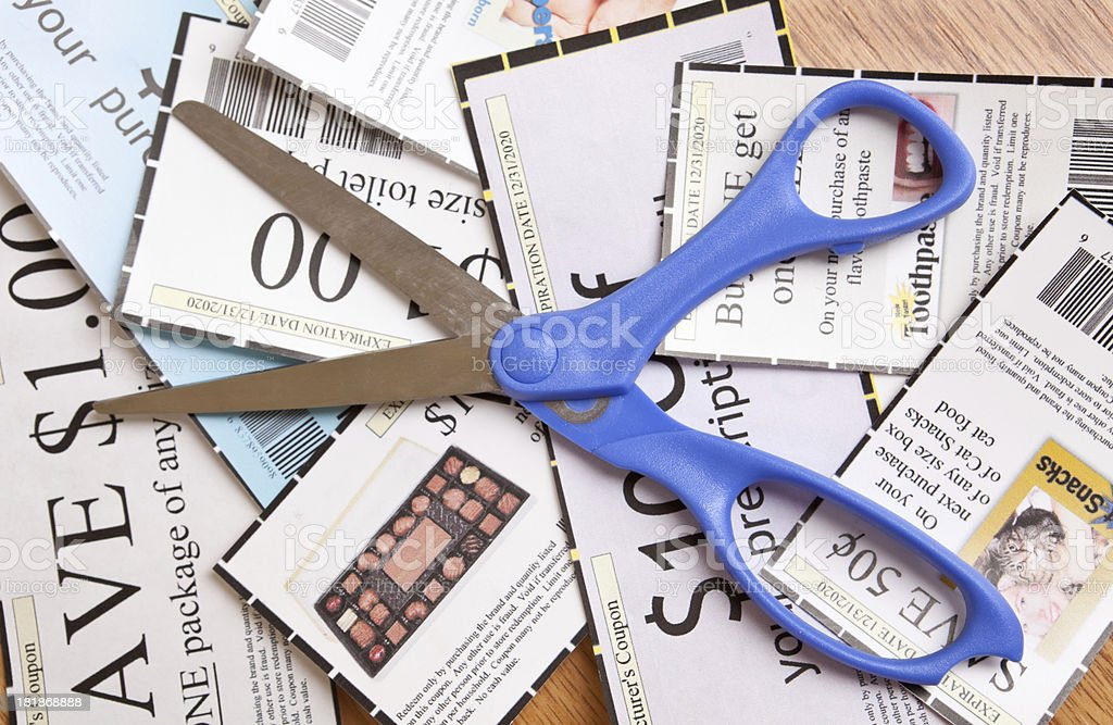 Scissors and Coupons stock photo
