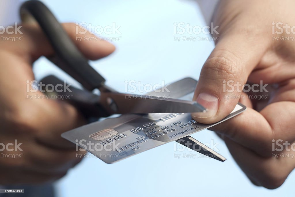 Scissors cutting a credit card royalty-free stock photo