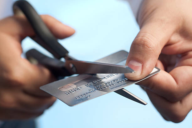 Scissors cutting a credit card stock photo