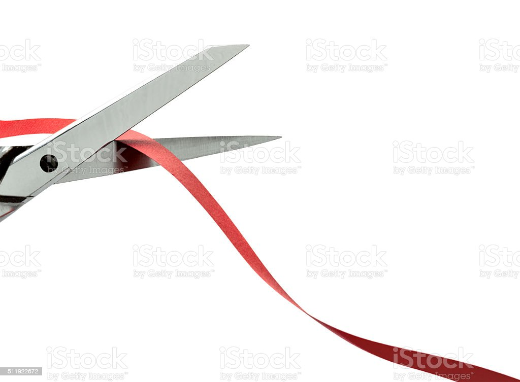 Scissors cutting a red ribbon. clipping path stock photo