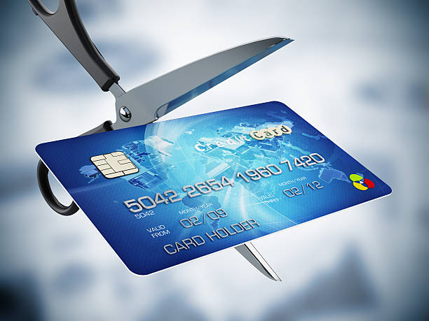 Scissors cutting credit card Scissors cutting credit card. debt ceiling stock pictures, royalty-free photos & images