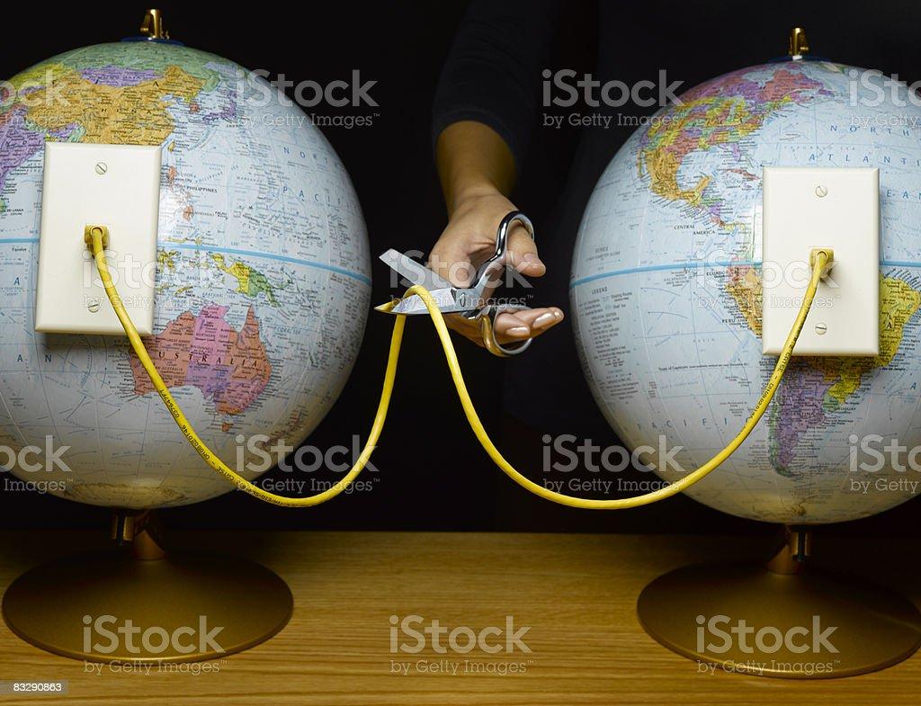 Forbici taglio cavo ethernet collegamento Globe foto stock royalty-free