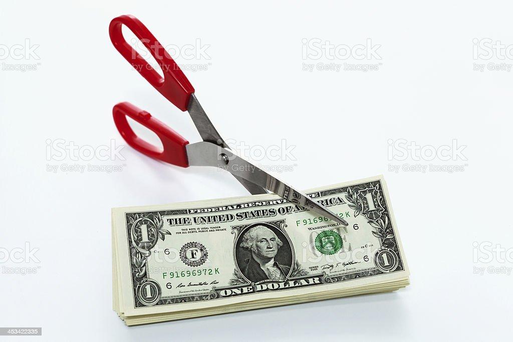 scissors cutting money stock photo