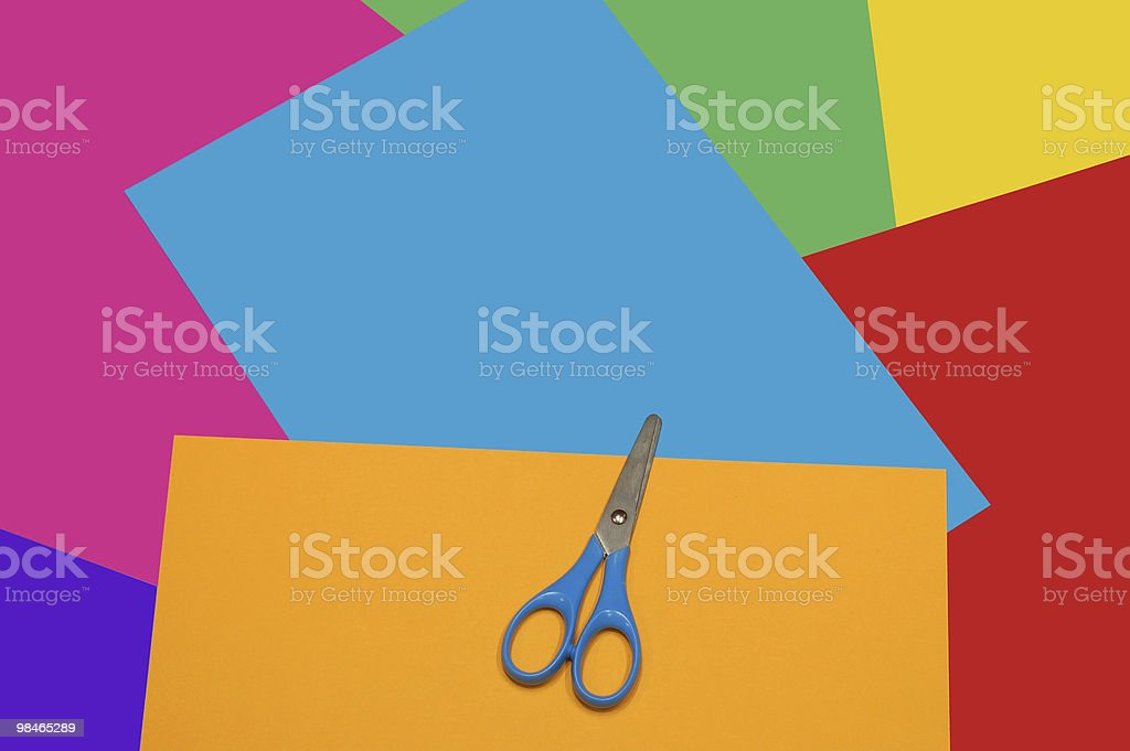 Scissors on color paper royalty-free stock photo
