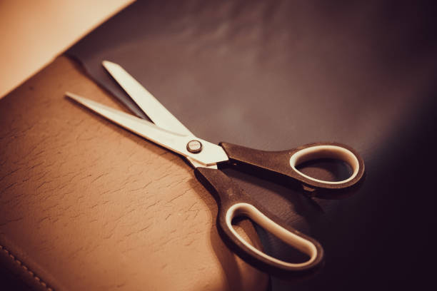 Scissors on the material during upholstering