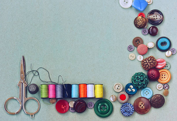 scissors, thread, needle, thimble, various buttons - seam stock photos and pictures