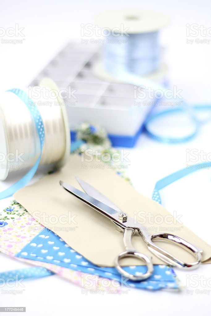 Scissors with ribbons and textiles stock photo