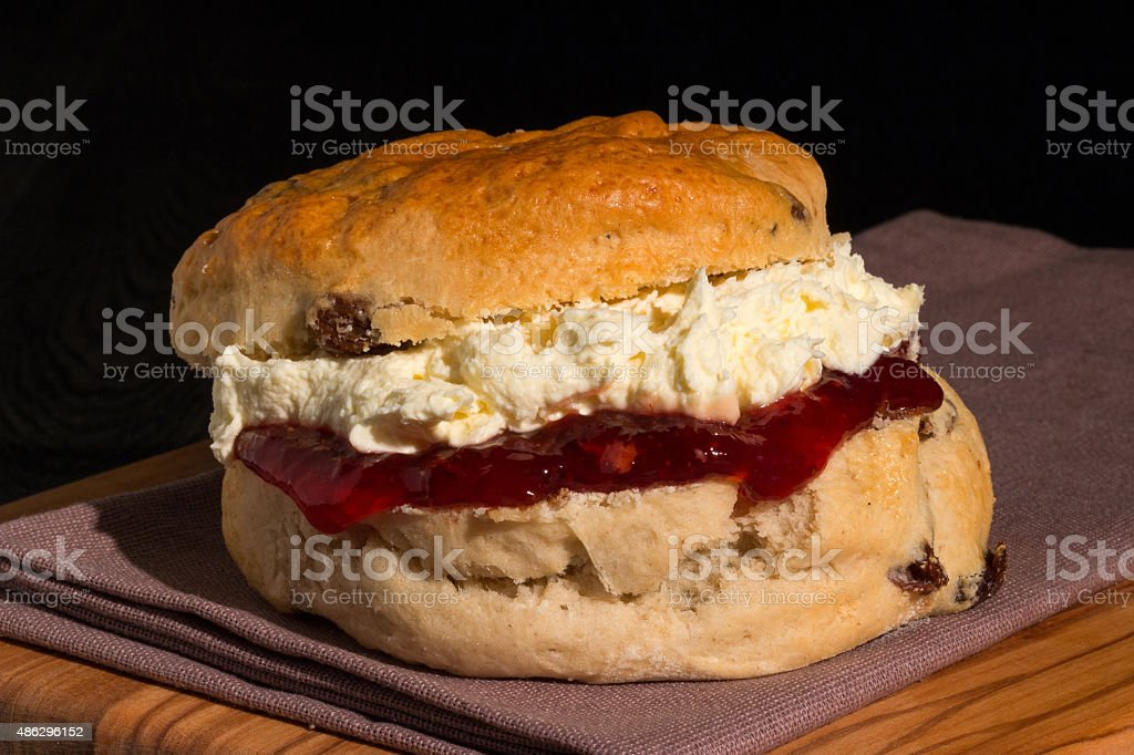Scone with jam and cream stock photo
