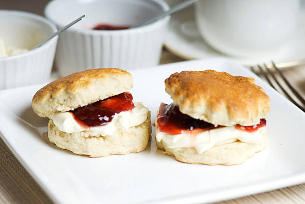 scones with cream and jam served with tea - scone bildbanksfoton och bilder