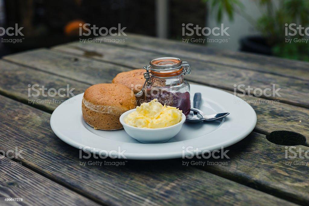 Scones with jam and cream stock photo