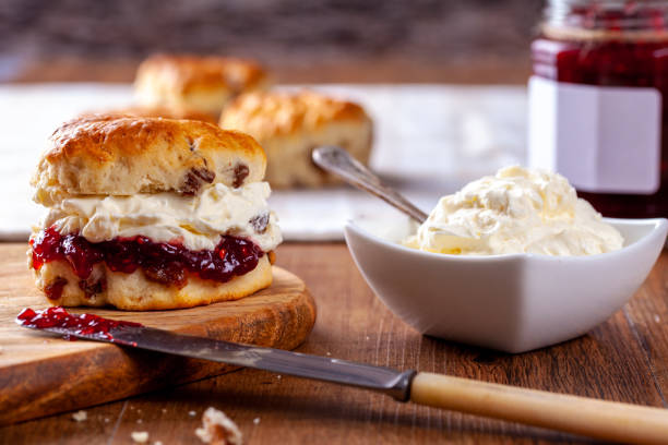 Scones with Strawberry Jam and Clotted Cream stock photo