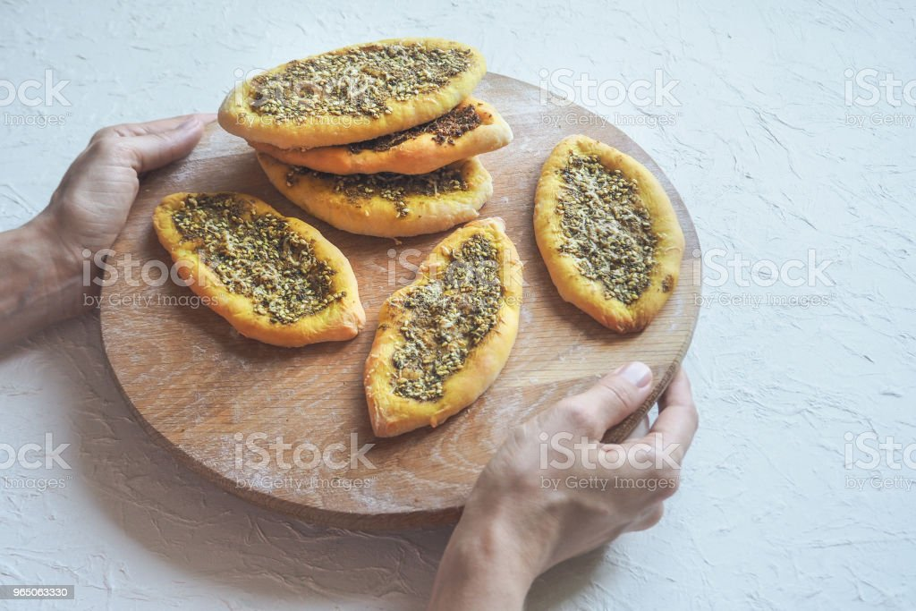 Scones with zatar. Manakish Arabic on a wooden tray. Arabic cuisine. royalty-free stock photo