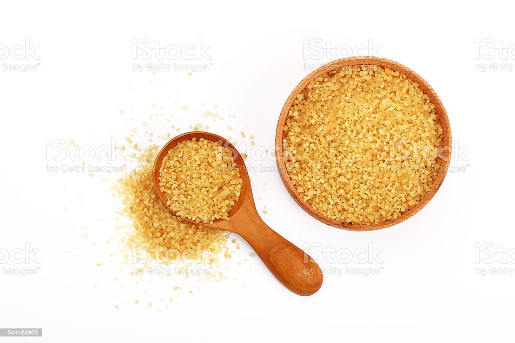 Scoop and bowl of brown cane sugar on white stock photo