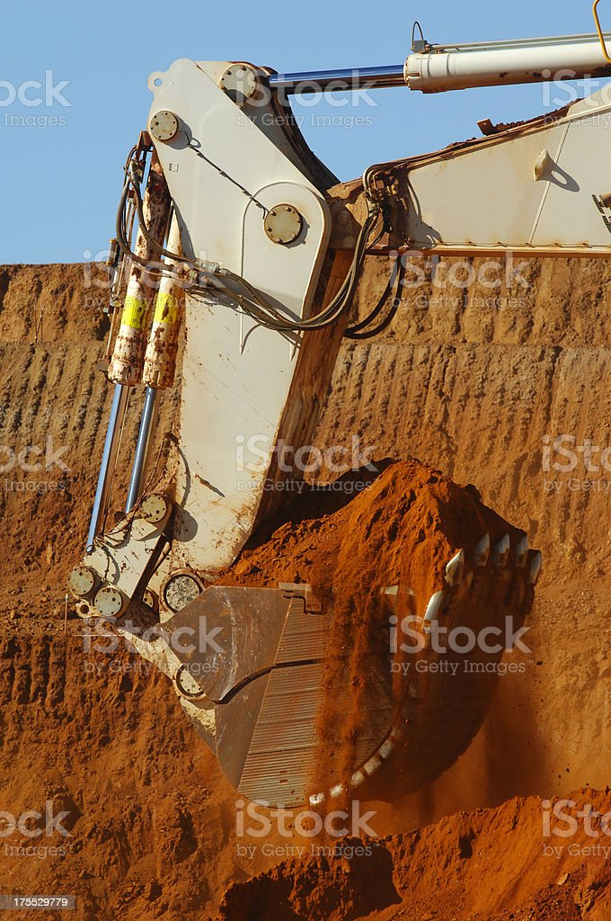 Scoop bucket loader lifting dirt. royalty-free stock photo