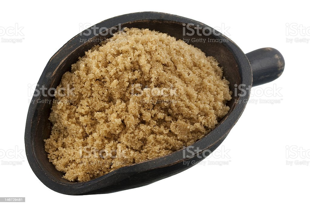 scoop of brown cane sugar royalty-free stock photo