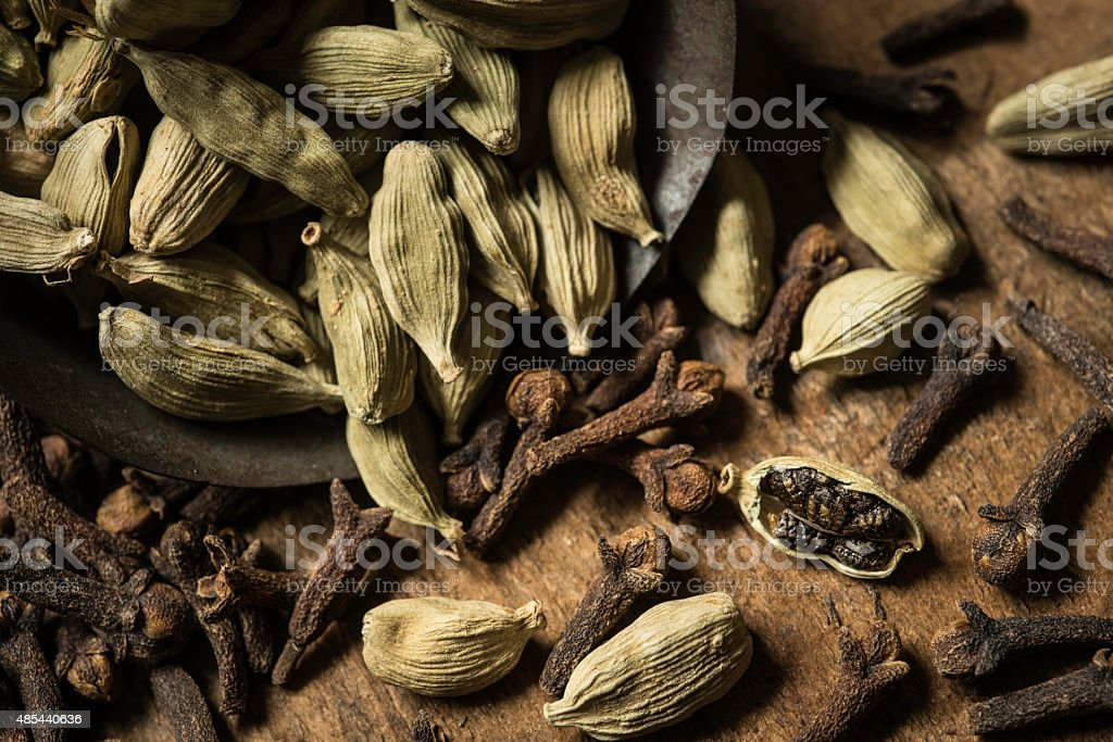 Scoop of Cardamom and Cloves stock photo