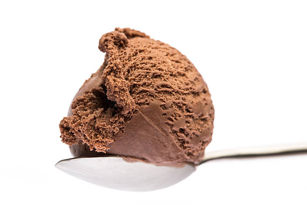 scoop of chocolate ice cream on a spoon stock photo