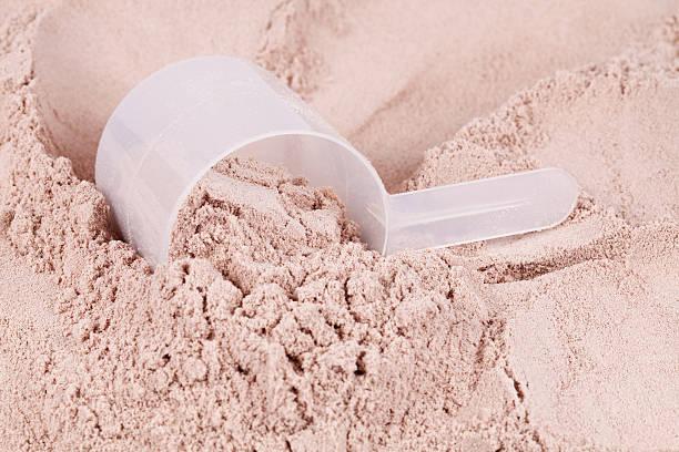 Scoop of chocolate whey isolate protein stock photo