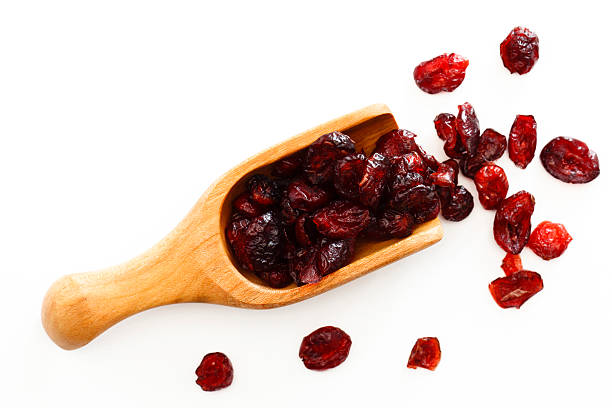 scoop of cranberries - dried food stock photos and pictures