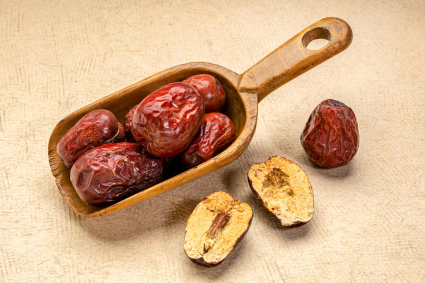 scoop of dried jujube fruits stock photo