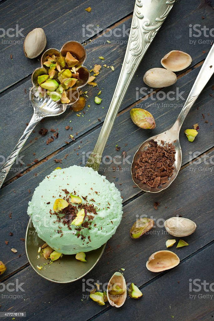 Scoop of homemade pistachio ice cream stock photo