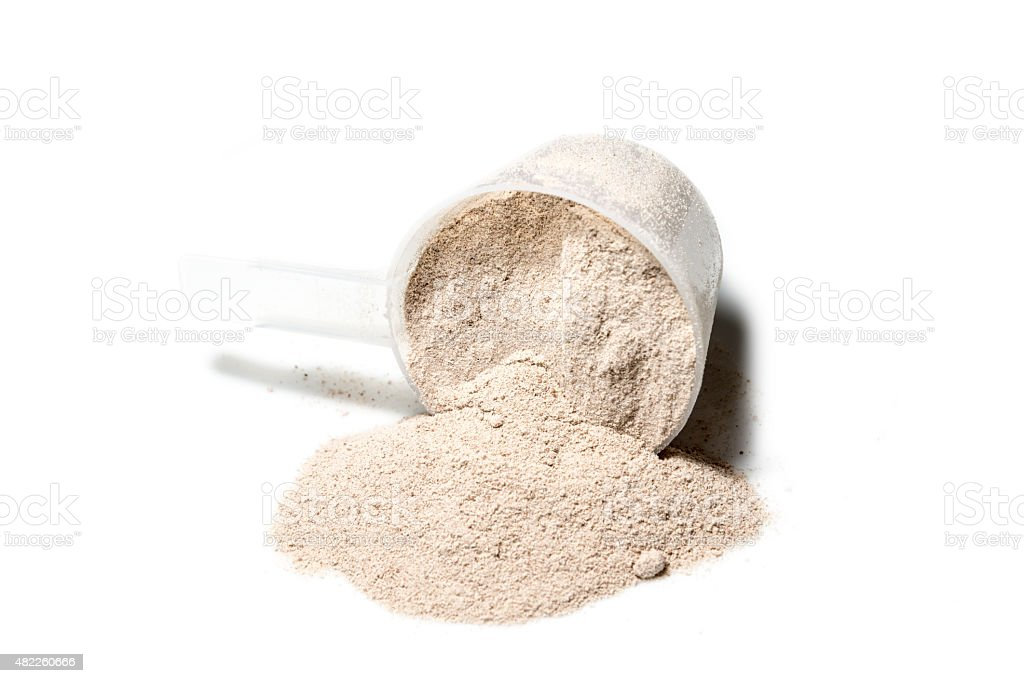 Scoop of Isolate protein powder chocolate deluxe flavour  poured stock photo