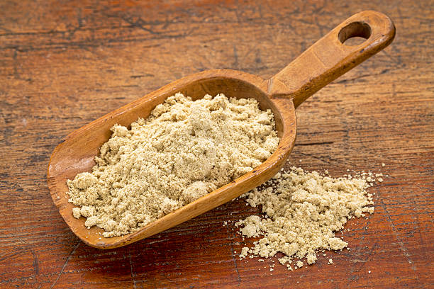 scoop of rice bran stock photo