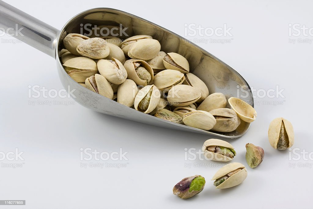 scoop of roasted and salted pistachios royalty-free stock photo