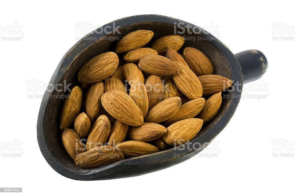 scoop of shelled almond nuts royalty-free stock photo
