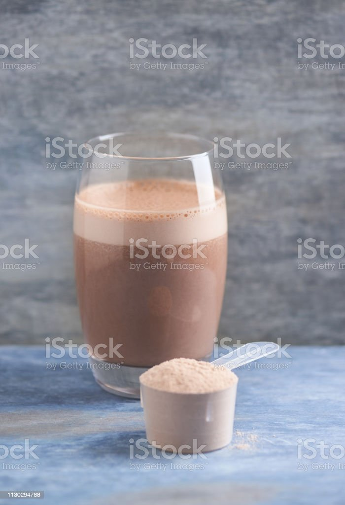 Scoop Of Whey Protein And A Glass Of Chocolate Protein Shake With Milk And Banana Sport Nutrition Wooden Background Copy Space Stock Photo Download Image Now Istock