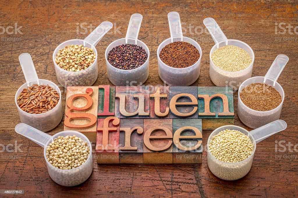 scoops gluten free grains  and text in wood type stock photo