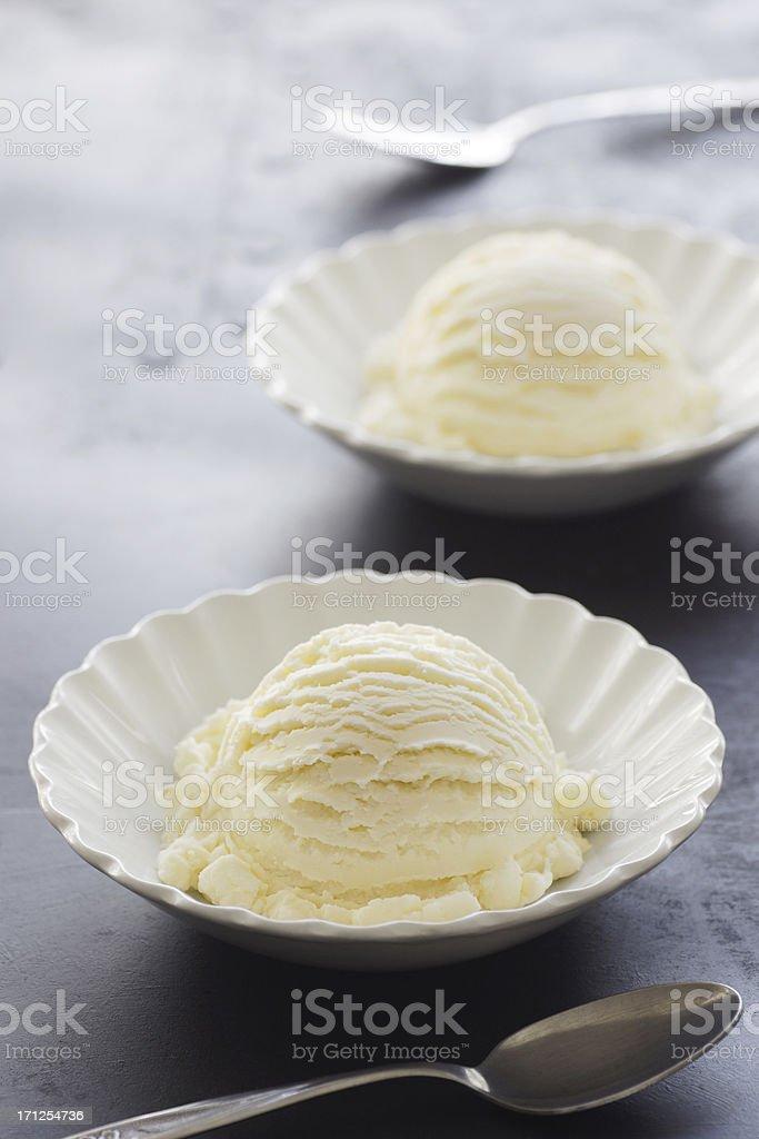 Scoops of Vanilla Ice Cream in Dishes stock photo