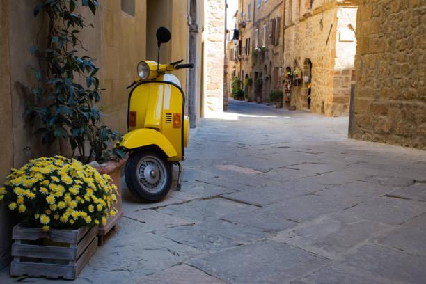 scooter at the empty street - milan fiorentina foto e immagini stock