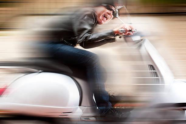 Scooter Fahrer in ein verrückt-ride – Foto