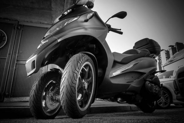 """PIAGGIO MP3 500 Scooter DSC01209 Hamburg, Germany - August 8. 2017: Parked PIAGGIO MP3 500 Scooter motorbike in Hamburg Germany. may be driven with the car license. thanks to the second front wheel, the machine is very good in the curves. Image was developed as """"black and white"""" three wheel motorcycle stock pictures, royalty-free photos & images"""