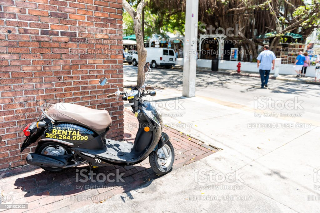 Scooter motor bike parked on Duval Street in Florida city travel,...