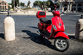Photo of a red scooter on Rome's streets