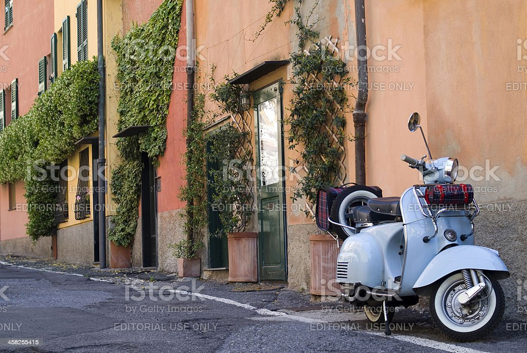 Scooter parked in the street royalty-free stock photo