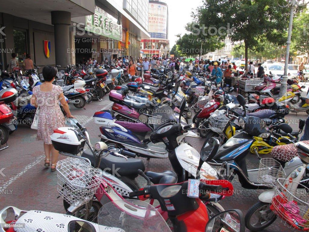 Scooter parking in Yinchuan main street, Ningxia Hui Region, China stock photo