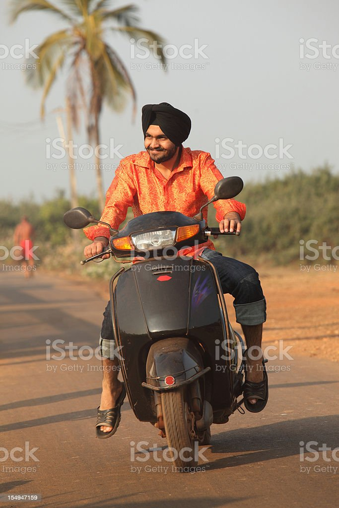 Scooter riding in Goa, India stock photo
