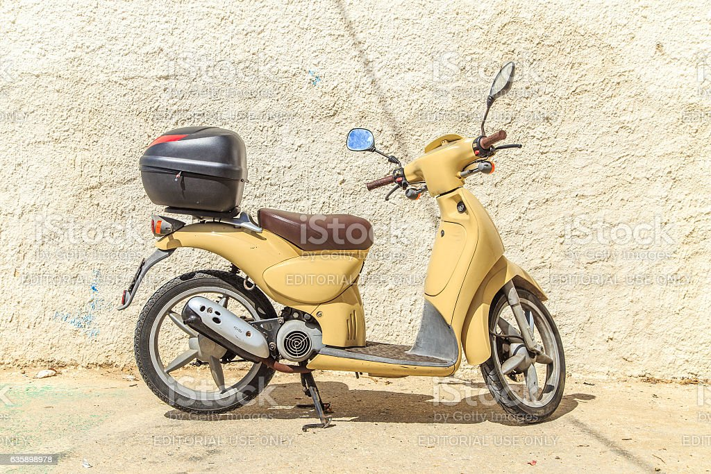 Scooter Vespa parked on old street in Bari, Italy stock photo