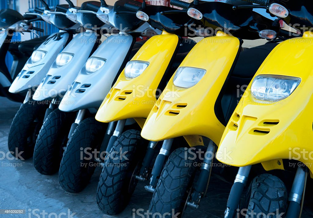 Scooters in a row stock photo