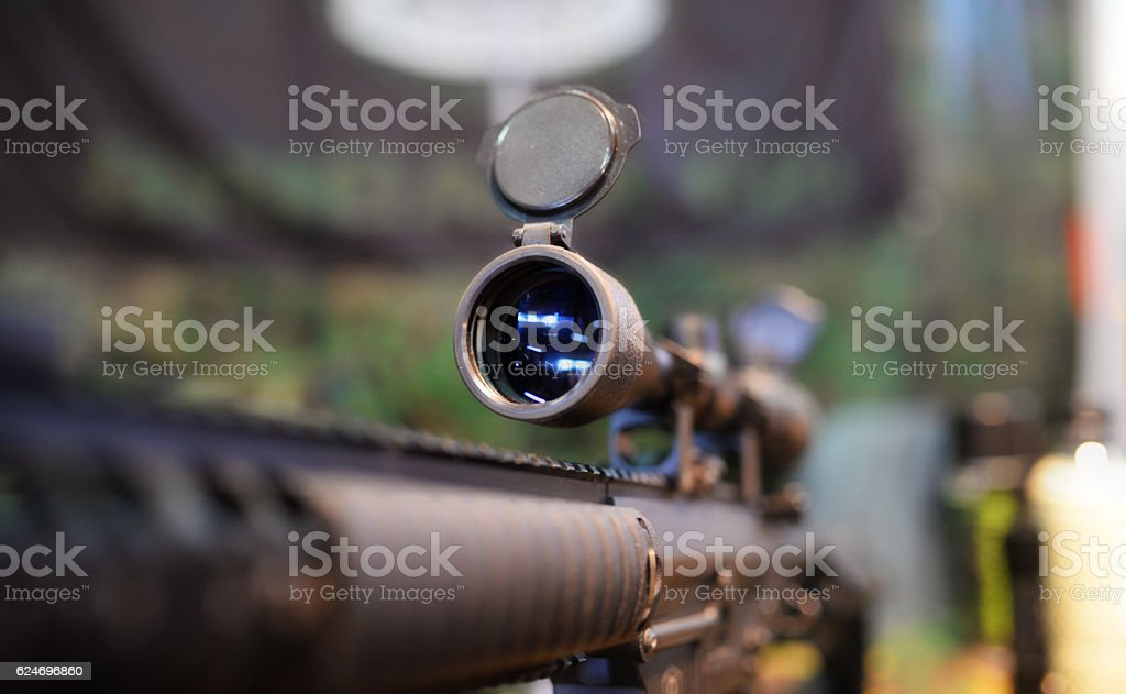 Scoped rifle in army shop stock photo