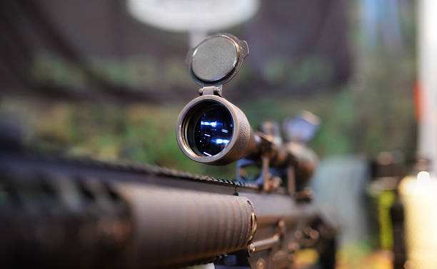 Scoped rifle in army shop Closeup of a rifle scope in army shop gun shop stock pictures, royalty-free photos & images