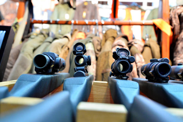 Scoped rifle in army shop Four Scoped rifle in army shop gun shop stock pictures, royalty-free photos & images