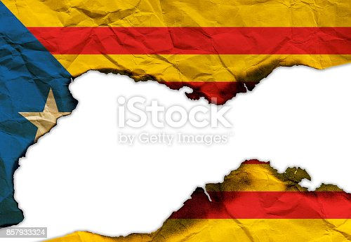 istock Scorched flag of Catalonia isolated on white background, concept picture about political situation in Spain 857933324