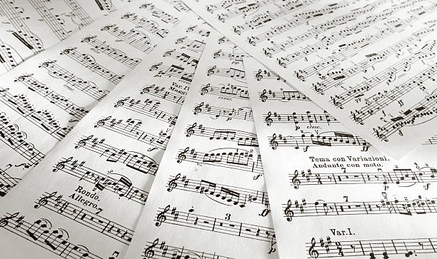 Scores Details of music scores printed on papers. sheet music stock pictures, royalty-free photos & images